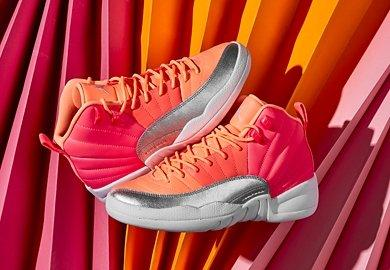 Get ready to feel tropical vibes with the latest edition of the girls' Air Jordan 12 'Hot Punch.'